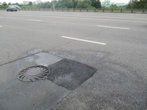 Заасфальтированная яма на Бесединском шоссе